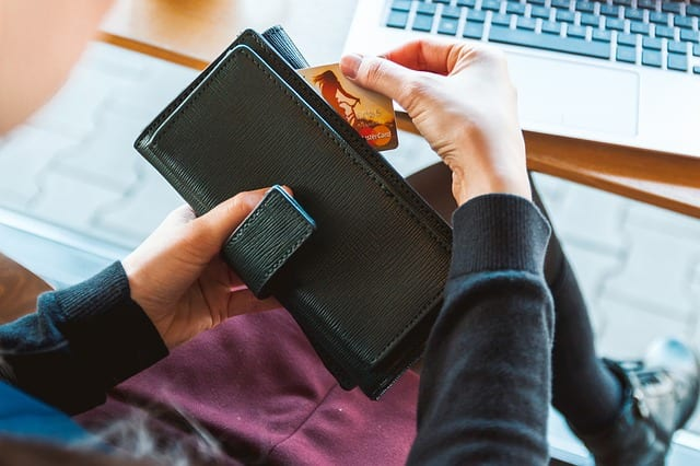 woman pulling credit card from a wallet