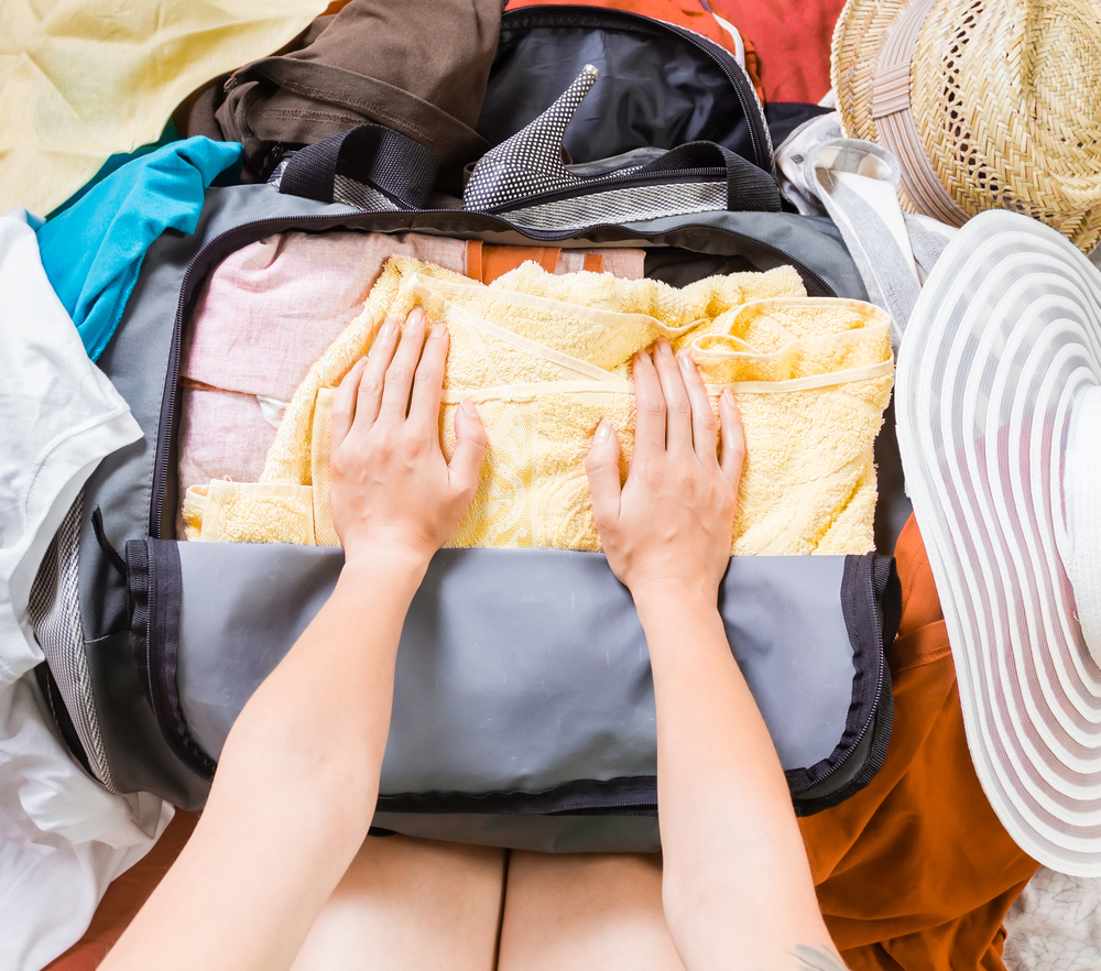Woman trying to pack for college
