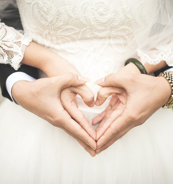 Couple Making Heart from Hand