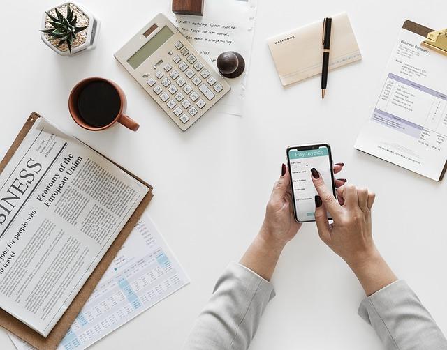 millennial entrepreneur paying invoice