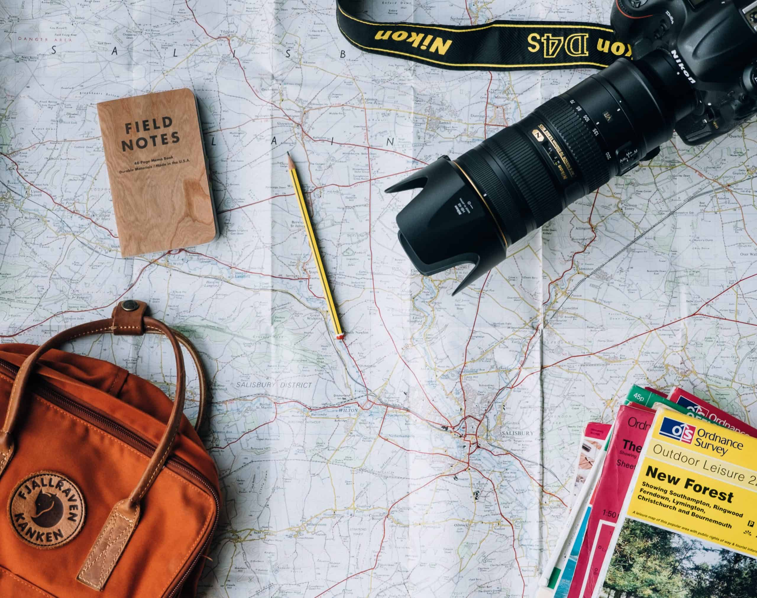 travel, map, camera, bag on desk - 6 Reasons Why You Should Learn Another Language Now