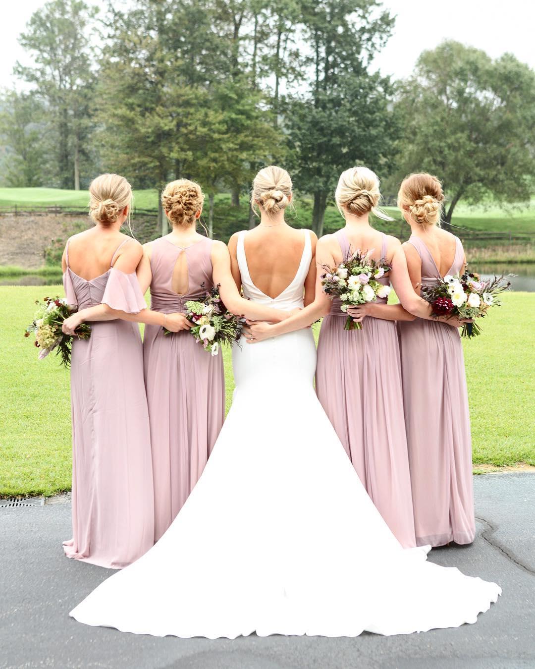bride with bridesmaids hugging