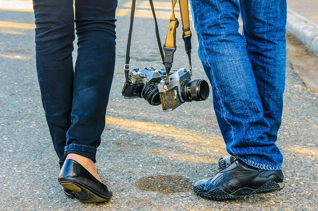 two people with cameras