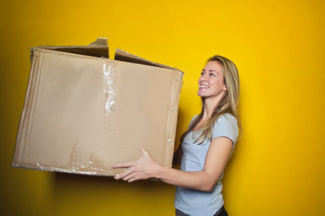 woman holding an old box
