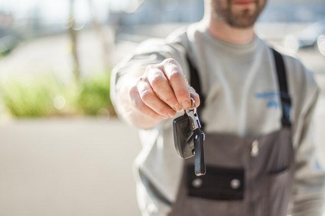 man and a car keys