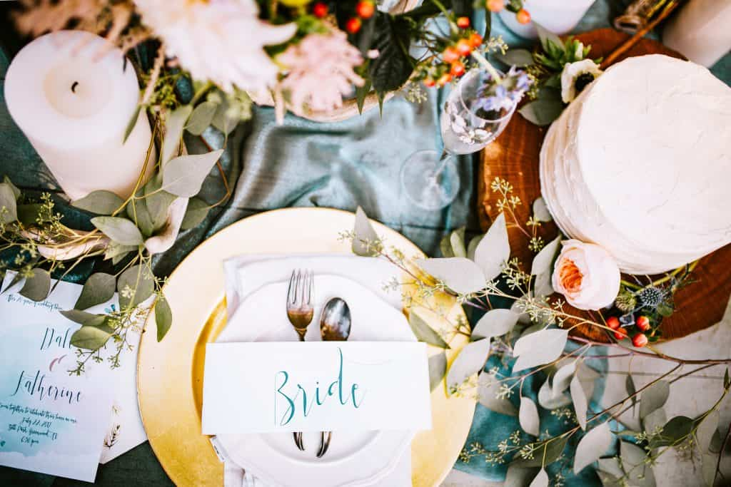 Artificial flowers decorating a place setting for a bride.